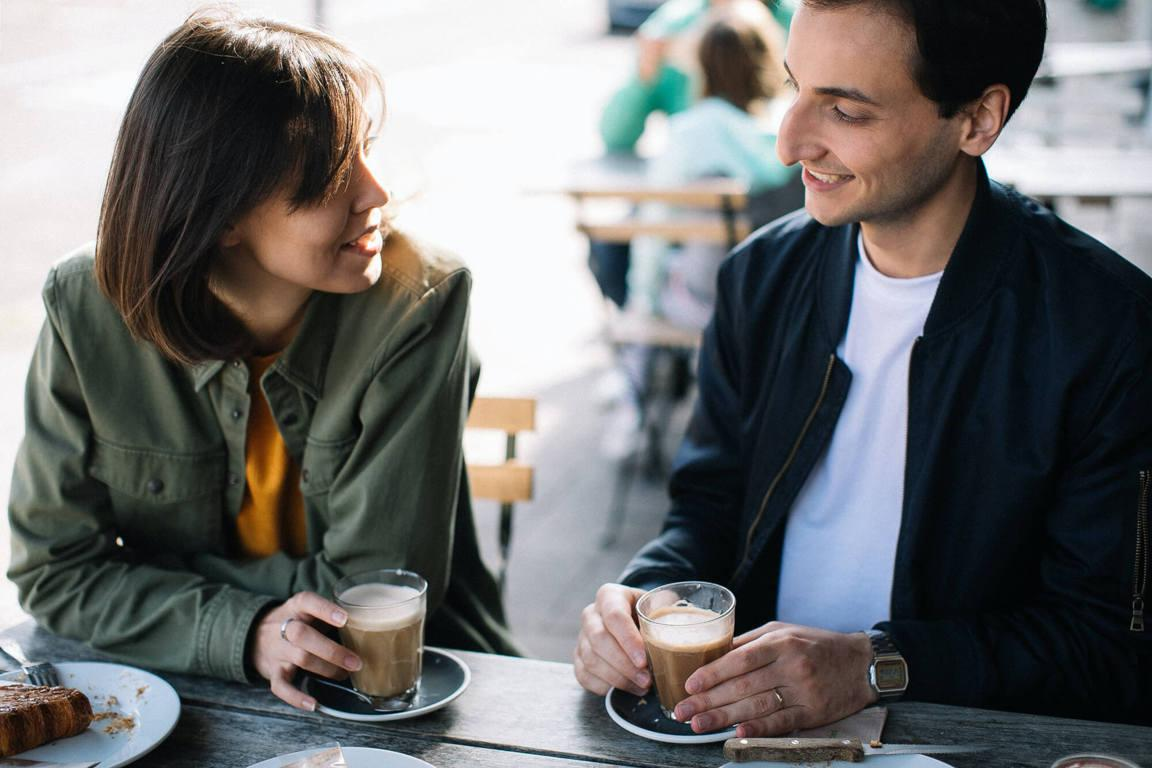 Man and woman dating over coffee while chatting