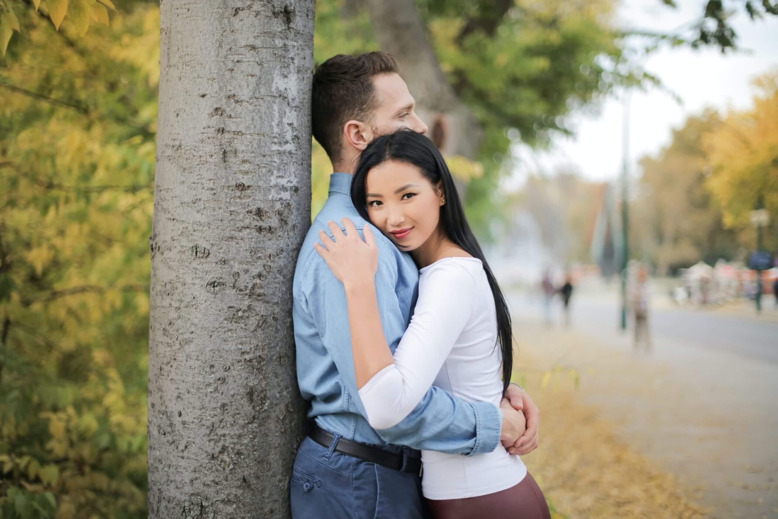 Couple hugging each other at the park