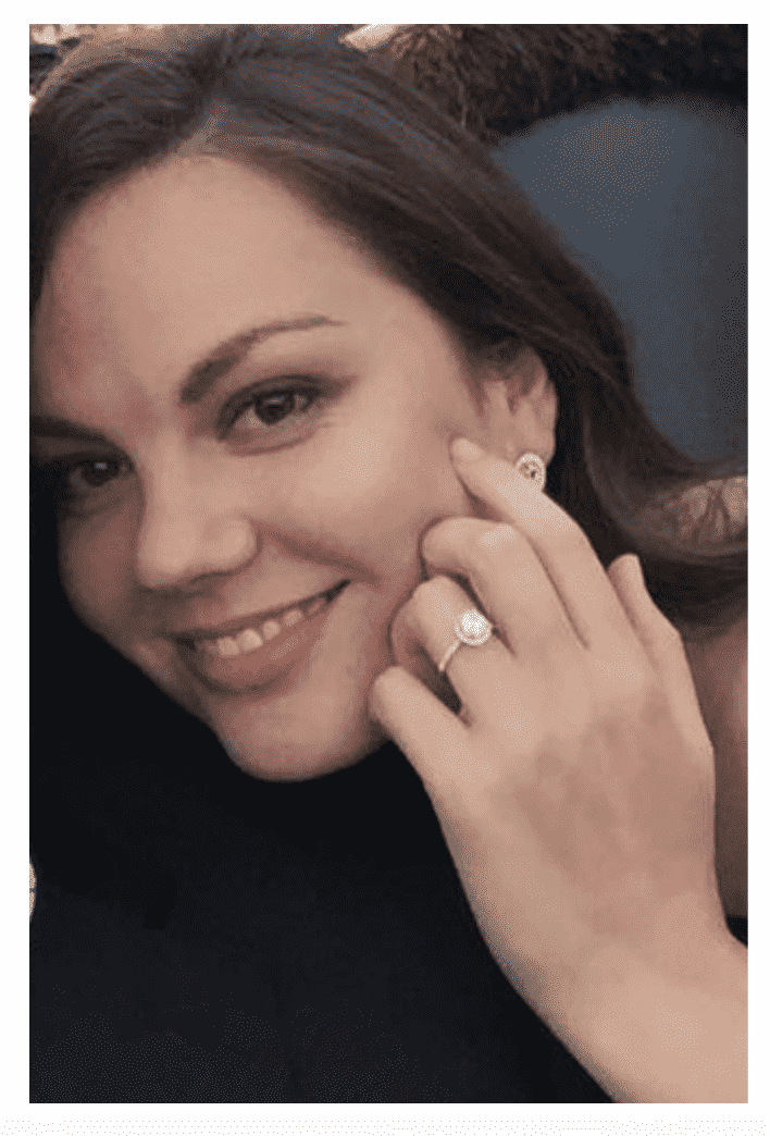 Woman showing her engagement ring