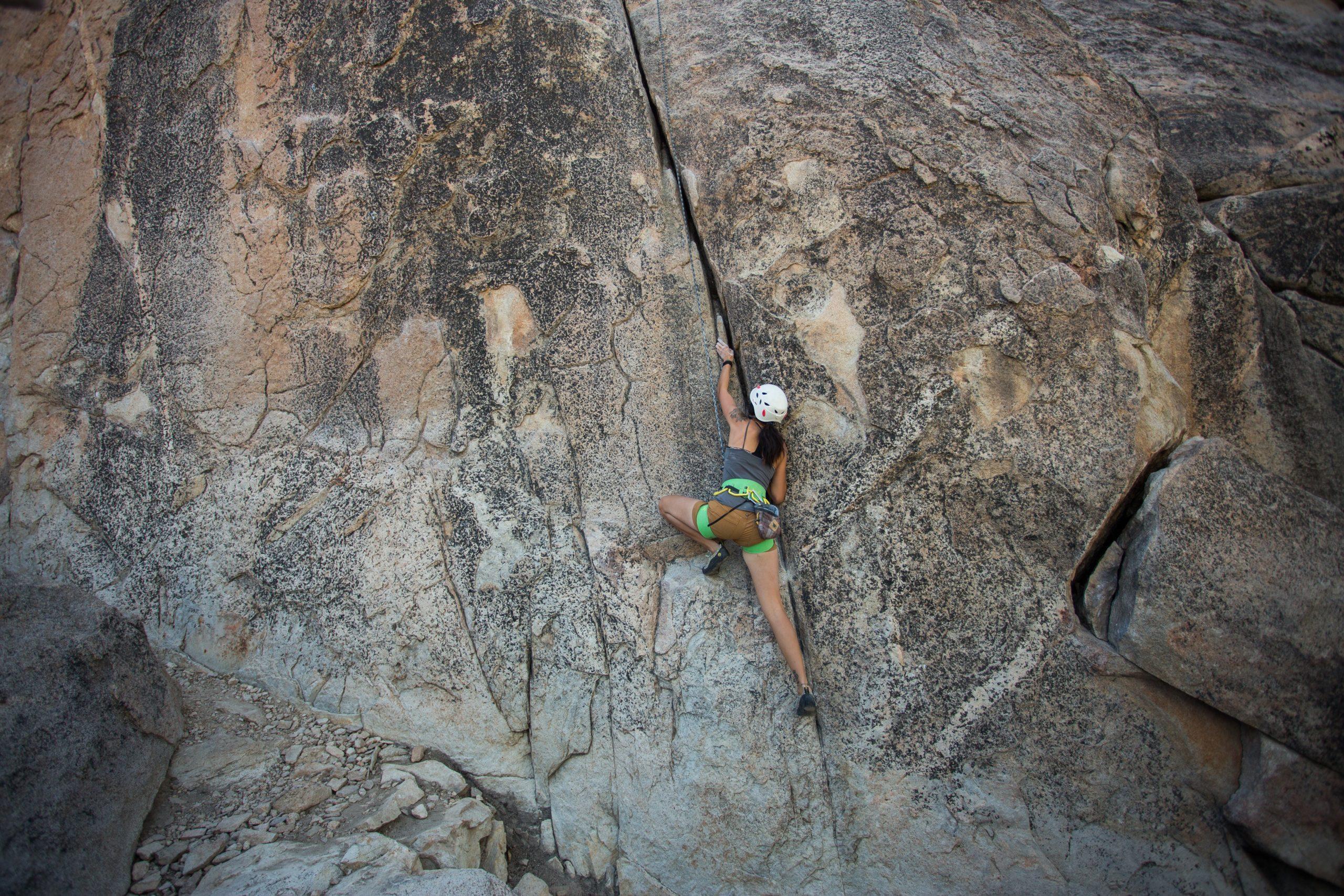 Single woman doing mountain climbing
