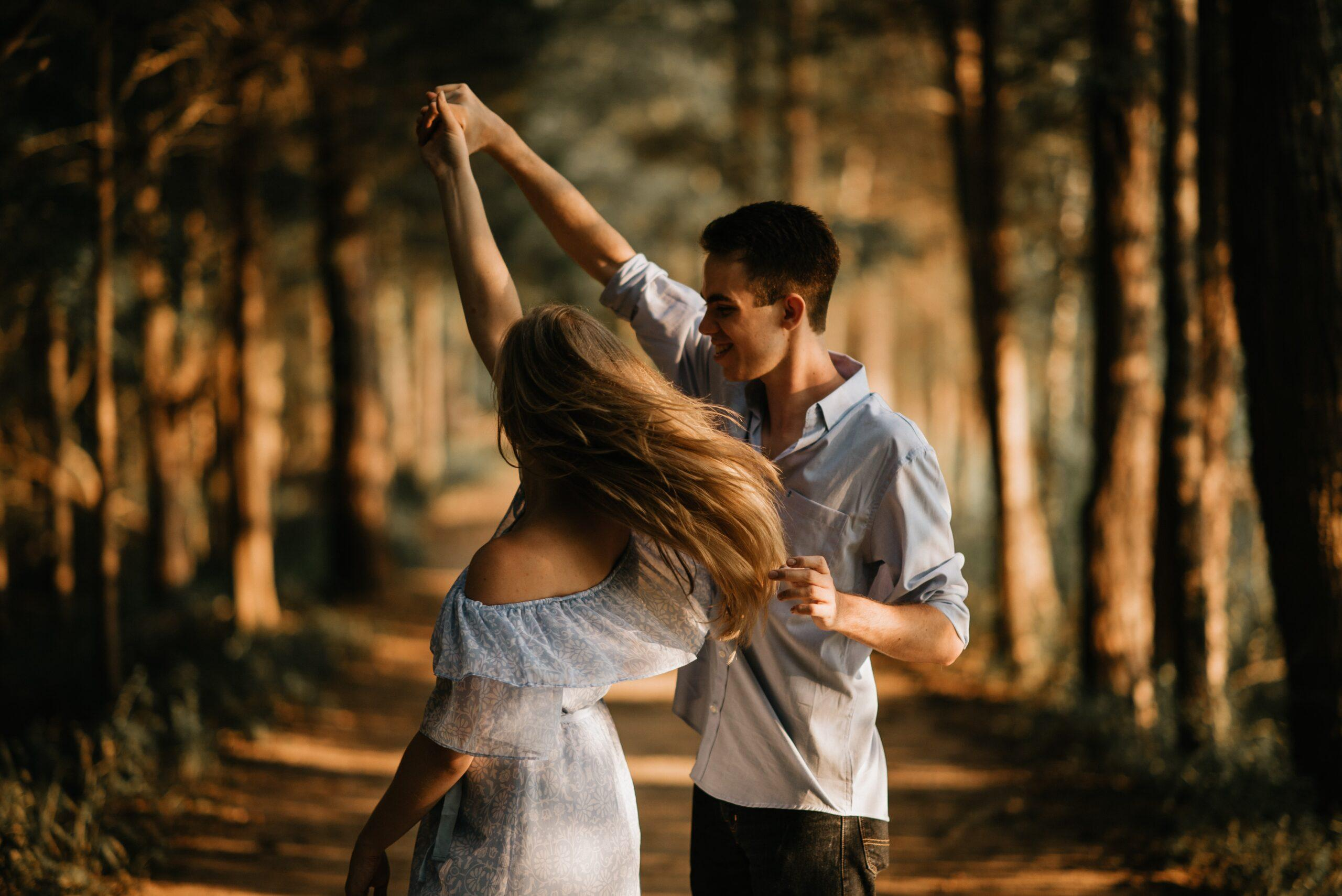 Young high-end singles dancing in the woods